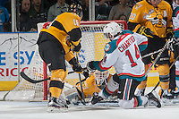 KELOWNA, CANADA - MAY 13: Rourke Chartier #14 of Kelowna Rockets tries to score a goal on Jordan Papirny #33 of Brandon Wheat Kings during the first period on May 13, 2015 during game 4 of the WHL final series at Prospera Place in Kelowna, British Columbia, Canada.  (Photo by Marissa Baecker/Shoot the Breeze)  *** Local Caption *** Jordan Papirny; Rourke Chartier;