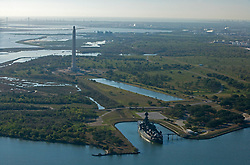 Aerial view of the historic Battleship Texas docked at Port of Houston with the San Jacinto Monument