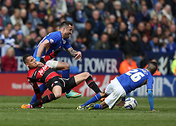Queen Park Rangers' Ravel Morrison is tackled by Leicester City's Marcin Wasilewski - Photo mandatory by-line: Matt Bunn/JMP - Tel: Mobile: 07966 386802 -19/04/2014 - SPORT - FOOTBALL - King Power Stadium- Leicester - Leicester City v Queens Park Rangers- Sky Bet Championship