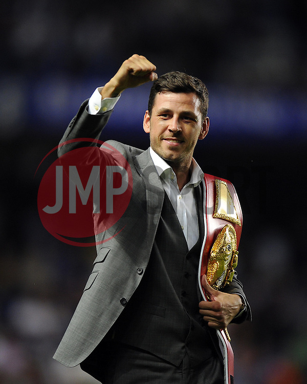 """Chelsea fan Darren Barker parades his belt around Stamford Bridge after his world title victory - Photo mandatory by-line: Joe Meredith/JMP - Tel: Mobile: 07966 386802 21/08/2013 - SPORT - FOOTBALL - Stamford Bridge - London - Chelsea V Aston Villa - Barclays Premier League - EDITORIAL USE ONLY. No use with unauthorised audio, video, data, fixture lists, club/league logos or """"live"""" services. Online in-match use limited to 45 images, no video emulation. No use in betting, games or single club/league/player publications"""
