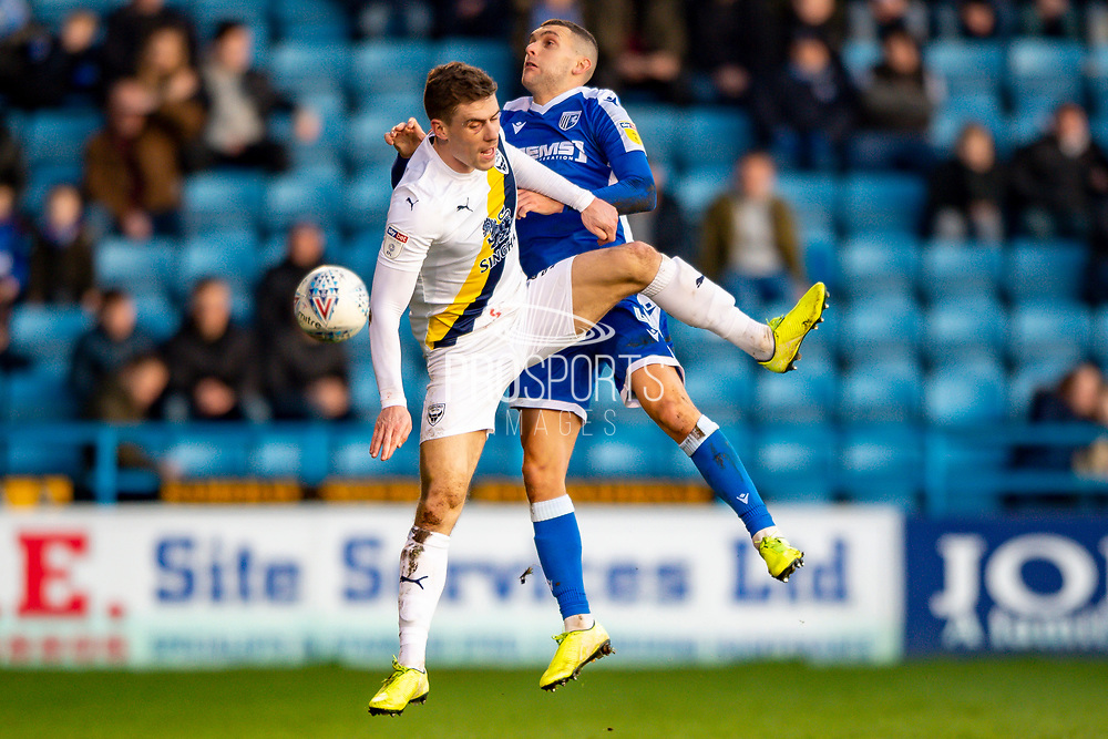 Oxford United defender Josh Ruffels   (3) and Gillingham FC midfielder Stuart O'Keefe (4)  during the EFL Sky Bet League 1 match between Gillingham and Oxford United at the MEMS Priestfield Stadium, Gillingham, England on 18 January 2020.
