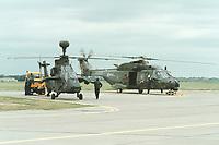 06 JUN 2000, BERLIN/GERMANY:<br /> Eurocopter EC 665 TIGER, der zukünftige Kampfhubschrauber der Bundeswehr, und NH 90, der zukünftige mittlere Transporthubschrauber der Bundeswehr, auf dem Boden nach einer Flugvorführung, Internationale Luftfahrausstellung, ILA 2000 <br /> IMAGE: 20000606-01/02-35<br /> KEYWORDS: Hubschrauber, helicopter, Armee, army, Waffe, wappon