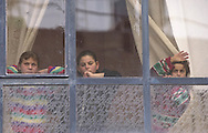 Three children of the 70 members in the Karaki family listen to exchange of fire between Palestinians and Israelis taking place outside of her home in the West Bank town of Hebron Friday Oct. 27, 2000. throughout a month of violence Karaki and 40,000 other Palestinian residents of central Hebron have endured a round the clock curfew that's kept them under house arrest and rendered their city in to a ghost town.