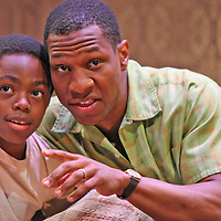 Derek Johnson as Travis Younger along with WALTER LEE - Jonathan Majors during the performance of Raisin in the Sun by Chautauqua Theater on the stage of the Bratton Theater in Chautauqua Institution July 2014 photo by Mark L. Anderson