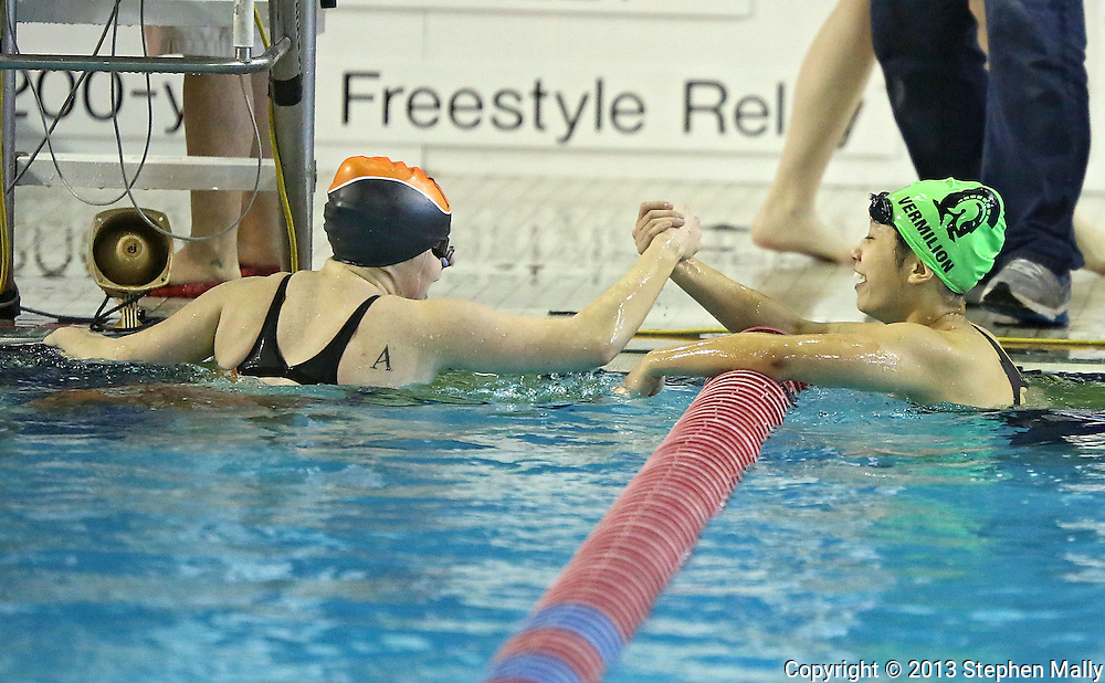 Ames' Sara Bentley (from left) greets Iowa City West's Lilian Zhu after the 100 yard backstroke event at the Girls' High School State Swimming & Diving Championships at the Marshalltown YMCA/YWCA in Marshalltown on Saturday, November 9, 2013. Bentley placed first with a time of 56.70 and Zhu placed second with a time of 57.27.