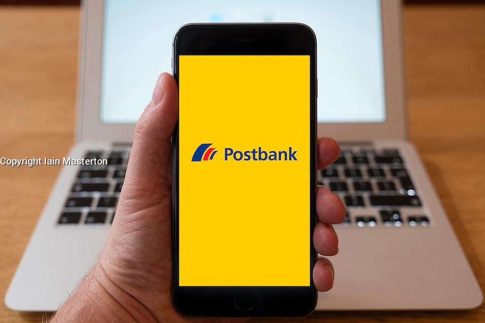 Using iPhone smart phone to display website logo of Postbank, German retail bank