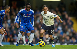 LONDON, ENGLAND - Saturday, December 4, 2010: Everton's Steven Pienaar and Chelsea's Michael Essien during the Premiership match at Stamford Bridge. (Pic by: David Rawcliffe/Propaganda)