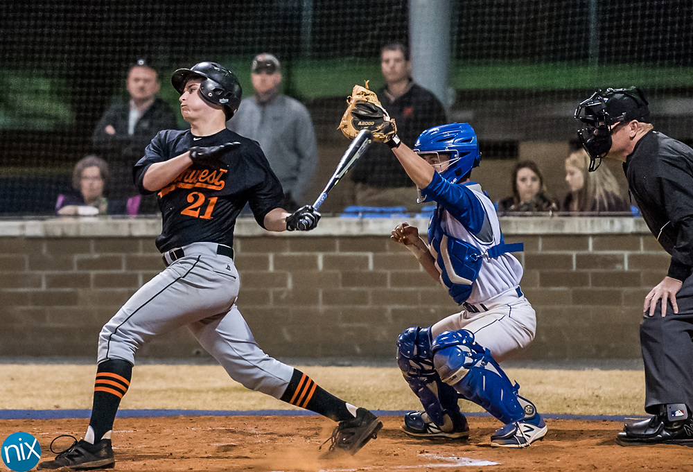 Northwest Cabarrus' Carson Bost (21) hits against Mount Pleasant Wednesday night at Mount Pleasant High School.