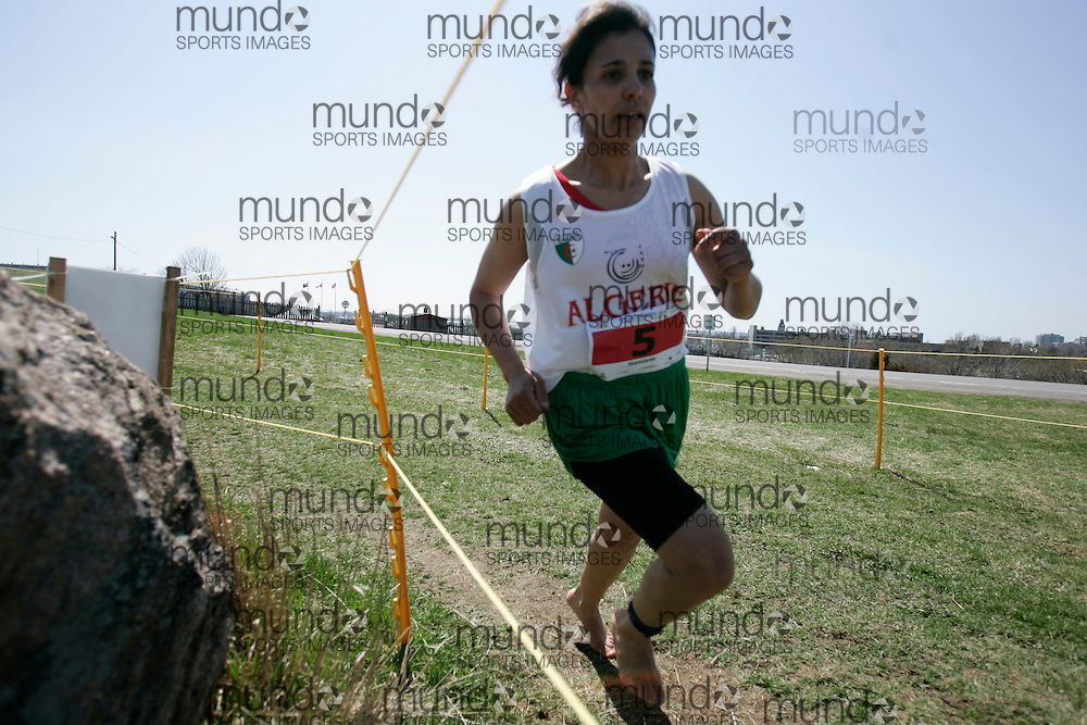 (Kingston, Canada---11 April 2010) Lynda Hamiane  (#5) of Algeria (ALG) runs in the \women's 5km race\ at the 17th World University Cross Country Championships (FISU) held on the Fort Henry Hill course in Kingston, Ontario, Canada. This photograph is Copyright Geoff Robins / Mundo Sport Images, 2010. For information, go to www.mundosportimages.com or contact info@mundosportimages.com.