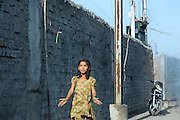 A girl is playing with a flying toy in New Arif Nagar, one of the water-affected colonies standing next to the abandoned Union Carbide (now DOW Chemical) industrial complex, site of the infamous 1984 gas tragedy in Bhopal, Madhya Pradesh, central India. The poisonous cloud that enveloped Bhopal left everlasting consequences that today continue to consume people's lives.