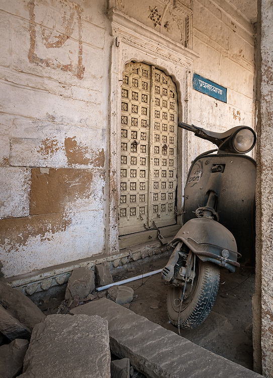 "JAISALMER, INDIA - CIRCA NOVEMBER 2018: Abandoned Motorbike in Jaisalmer.  Jaisalmer is also called ""The Golden City, and it is located in Rajasthan. . The town stands on a ridge of yellowish sandstone, and is crowned by the ancient Jaisalmer Fort."