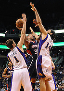 Mar. 1, 2013; Phoenix, AZ, USA; Atlanta Hawks forward Dahntay Jones (30) goes up with the ball against the Phoenix Suns guard Goran Dragic (1) and forward Luis Scola (14) in the first half at US Airways Center. Mandatory Credit: Jennifer Stewart-USA TODAY Sports