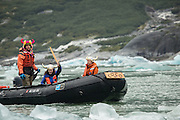 Crew from the National Geograhic Sea Lion arrive in the Coco Boat to deliver hot chocolate to guests as they explore Dawes Glacier, part of the Tracy Arm - Fords Terror Wilderness, Alaska.