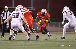 25 October 2014: Marshaun Coprich cuts through an opening and rushes between the tackles in a well defined opening during an NCAA Missouri Valley Conference game between the Missouri State Bears and the Illinois State Redbirds at Hancock Stadium in Normal, Illinois.