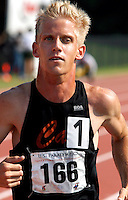Peter Gottwald Jr. sweats through a T13 (vision-impaired) 10,000-meter run on the Lakewood Stadium track on Sunday, July 2, 2006. Over 200 athletes entered the U.S. Paralympic Track & Field National Championships this year. Many of them will be racing again in the Peachtree Road Race on Tuesday.