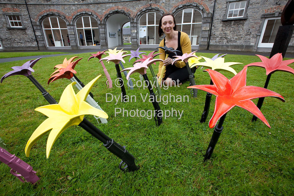 21/7/2009.Pictured in Castle Yard Kilkenny is Ann Mulrooney, Exhibitions Manager and Curator at the National Craft Gallery with Power Flowers by ceramicist Adele Stanley in a display of outdoor work as part of the crafts strand during Kilkenny Arts Festival..Picture Dylan Vaughan.