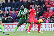 Jean-Yves M'voto of Leyton Orient and Bayo Akinfenwa of AFC Wimbledon tussle during Sky Bet League 2 match between Leyton Orient and AFC Wimbledon at the Matchroom Stadium, London, England on 28 November 2015. Photo by Stuart Butcher.