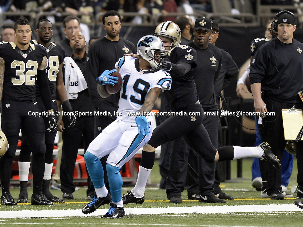 Dec. 8, 2013 - New Orleans, LA, USA - Carolina Panthers' Ted Ginn, Jr. (19) gets face-masked by New Orleans Saints' Thomas Morstead (6) in the first quarter at the Mercedes-Benz Superdome in New Orleans on Sunday, Dec. 8, 2013.