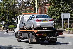 © Licensed to London News Pictures . 16/07/2017 . Manchester , UK . A silver BMW is towed from the scene . The Independent Police Complaints Commission have been informed following a road traffic accident near Stockport . Reports say a car struck two elderly people on the A6 Buxton Road in Heaviley at the junction with Kennerley Road and that two young males were detained by members of the public and police as they tried to make off from the scene . An undamaged silver BMW and a badly damaged dark grey Renault Clio were towed from the scene and surrounding roads have been closed to traffic as an investigation is carried out . Photo credit : Joel Goodman/LNP