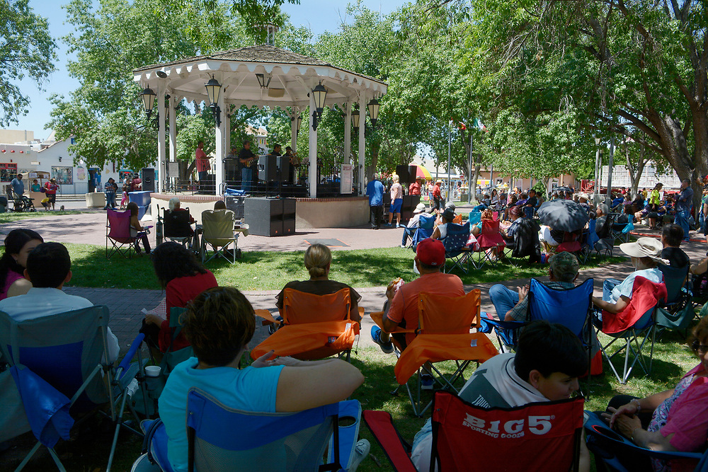 gbs060417e/ASEC -- The audience brought their own chairs to listen to the music of Mike Romero y La Raza in Old Town Plaza during the San Felipe de Neri Fiesta on Sunday, June 4, 2017. (Greg Sorber/Albuquerque Journal)