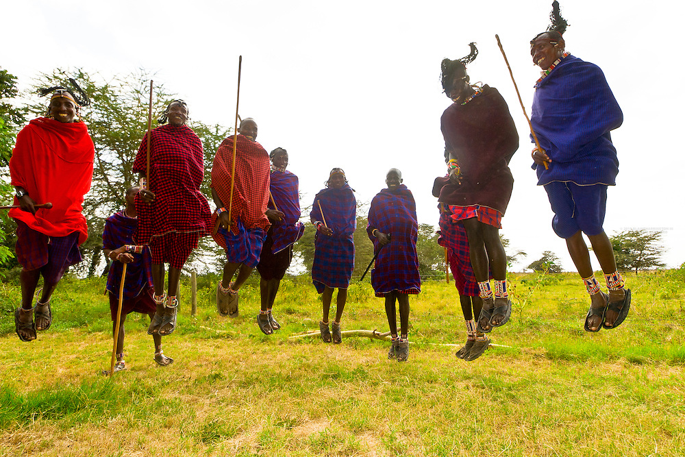 Maasai warriors doing Adumu (traditional jumping dance), Amboseli National Park, Kenya