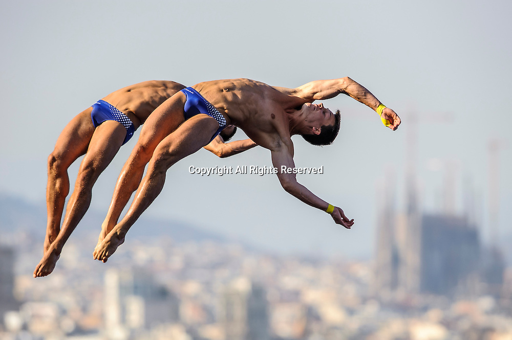 21.07.2013 Barcelona, Spain. Sascha Klein and Patrick Hausding of Germany (GER) perform their last dive to secure the Gold medal during the Mens 10m Synchronised Platform Diving Final on Day 2 of the 2013 FINA World Championships, at the Piscina Municipal de Montjuic.