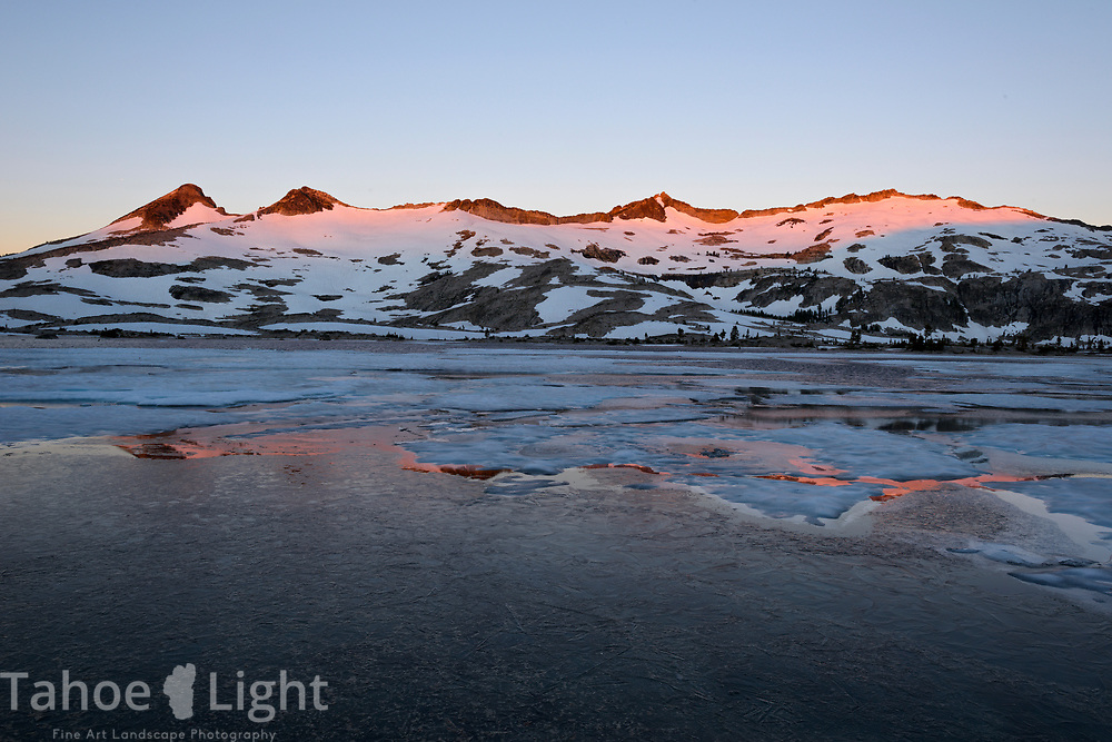 Sunrise on Pyramid Peak behind Lake Aloha in the Desolation wilderness area in south lake tahoe.