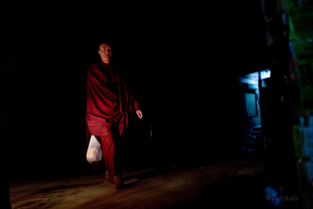 INDIA - Life in Exile (Tibetan Refugees) <br /> A monk makes his way through town of McLeod Ganj, Dharamsala, India, where the Dalai Lama settled after fleeing Tibet in 1959 after a failed uprising against Chinese rule, May 25, 2009.