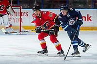 PENTICTON, CANADA - SEPTEMBER 11: Glenn Gawdin #80 of Calgary Flames is checked by Tyler Boland #89 of Winnipeg Jets on September 11, 2017 at the South Okanagan Event Centre in Penticton, British Columbia, Canada.  (Photo by Marissa Baecker/Shoot the Breeze)  *** Local Caption ***