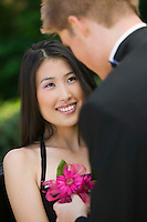 Teenage Girl Receiving Corsage from Date