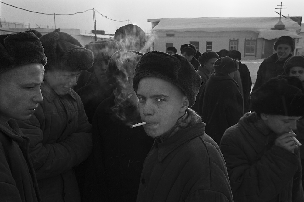 Russian young prisoners smoke cigarettes during morning stroll at the colony for prisoner's children in Siberian town Leninsk-Kuznetsky, Russia, 26 January 2000.