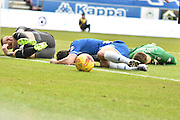 There is a clash in the bury box  during the Sky Bet League 1 match between Wigan Athletic and Bury at the DW Stadium, Wigan, England on 27 February 2016. Photo by Mark Pollitt.
