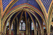 Detail of ribs underlined with red strips and golden L on the vaults decorated with fleur de lys in the choir of the lower chapel of La Sainte-Chapelle (The Holy Chapel), 1248, Paris, France. La Sainte-Chapelle was commissioned by King Louis IX of France to house his collection of Passion Relics, including the Crown of Thorns. It is considered among the highest achievements of the Rayonnant period of Gothic architecture. Picture by Manuel Cohen