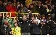 Picture by Paul Chesterton/Focus Images Ltd.  07904 640267.09/04/12.The traveling Norwich fans celebrate their sides 2nd goal during the Barclays Premier League match at White Hart Lane Stadium, London.