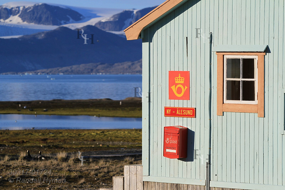Northernmost post office in the world at the international science village of Ny-Alesund overlooks fjord of Kongfjorden on Spitsbergen island; Svalbard, Norway.