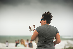September 9, 2017 - Fort Lauderdale, Florida, U.S - Erika Montoya of Fort Lauderdale visits the beach in Fort Lauderdale with her dog as Hurricane Irma approaches Florida and wind starts to pick up. (Credit Image: © Orit Ben-Ezzer via ZUMA Wire)