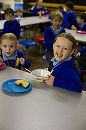 Pupils at St. Gregory's Catholic Primary School in Liverpool attending a pre-school club run by Magic Breakfast. The charity provides healthy school breakfasts to hungry and malnourished children in disadvantaged parts of the UK. It is estimated that over half-a-million children in the UK arrive at school each day too hungry to learn.