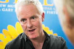 """© Licensed to London News Pictures . 12/01/2016 . Salford , UK . Writer TIM FIRTH backstage after making a surprise appearance at the Lowry Theatre ,  during the opening week of """" The Girls """" , a musical he wrote with Gary Barlow , based on the story """" Calendar Girls """" , about a group of Women's Institute members in Yorkshire , who made a nude calendar . Photo credit : Joel Goodman/LNP"""