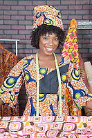 Portrait of an African American female fashion designer with pattern cloth