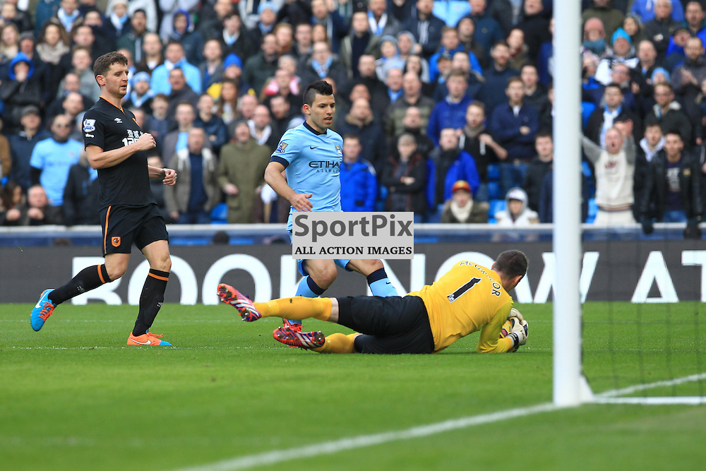 Hull City goalkeeper Allan McGregor saves at the feet of Manchester City forward Sergio Aguero during the Manchester City FC v Hull City FC English Premier League 7th February 2015...©Edward Linton | SportPix.org.uk