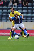 AFC Wimbledon defender Jon Meades (3) gets hold of Rochdale FC midfielder Ollie Rathbone (14) during the EFL Sky Bet League 1 match between Rochdale and AFC Wimbledon at Spotland, Rochdale, England on 27 August 2016. Photo by Stuart Butcher.