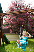 Hayley Kudro, 6, swings outside her home, in Waynesboro, Virginia on Wednesday, June 15, 2011. Hayley, then 5, was diagnosed with a softball-sized mass near her liver that turned out to be neuroblastoma in September of 2009.