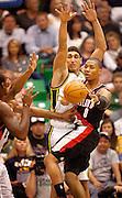 Enes Kanter goes up for the block as Damian Lillard, right, passes the ball during a preseason game at EnergySolutions Arena in Salt Lake City, Thursday, Oct. 25, 2012.
