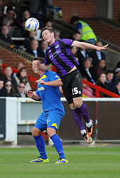 Bristol Rovers' Seanan Clucas challenges AFC Wimbledon's Peter Sweeney to the header - Photo mandatory by-line: Dougie Allward/JMP - Mobile: 07966 386802 05/04/2014 - SPORT - FOOTBALL - Kingston upon Thames - Kingsmeadow - AFC Wimbledon v Bristol Rovers - Sky Bet League Two