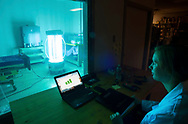 """Scientist Mairead Smith (r), tests a """"robot"""" that disinfects hospital rooms with ultraviolet light at ECRI, a medical research facility Thursday, March 2, 2017 in Plymouth Meeting, Pennsylvania. (WILLIAM THOMAS CAIN / For The Philadelphia Inquirer)"""