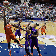 UNCASVILLE, CONNECTICUT- JULY 15:  Chiney Ogwumike #13 of the Connecticut Sun drives to the basket  past her sister Nneka Ogwumike #30 of the Los Angeles Sparks during the Los Angeles Sparks Vs Connecticut Sun, WNBA regular season game at Mohegan Sun Arena on July 15, 2016 in Uncasville, Connecticut. (Photo by Tim Clayton/Corbis via Getty Images)