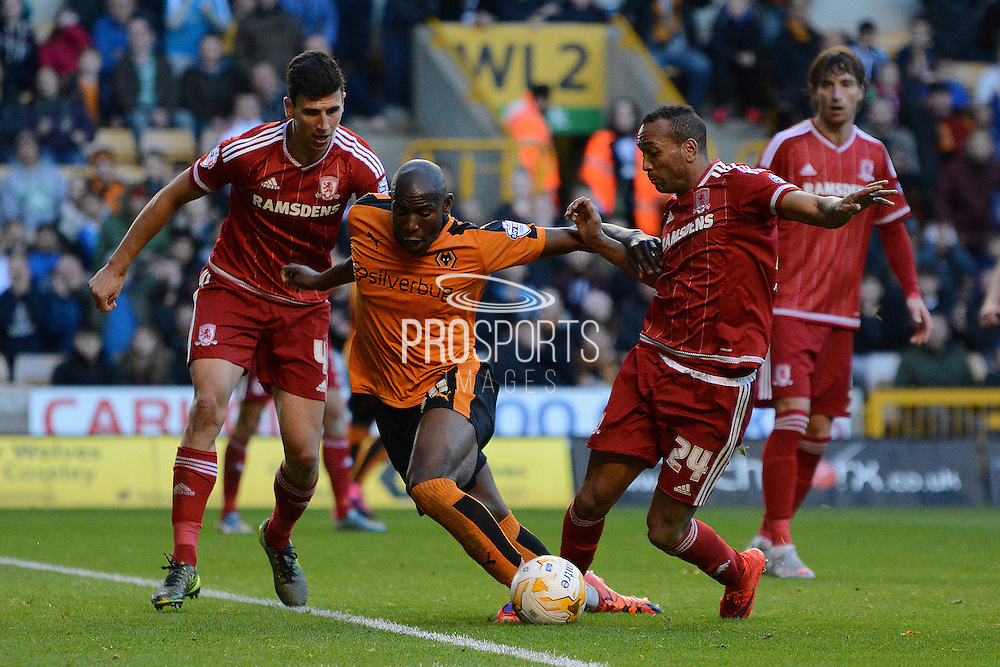Wolverhampton Wanderers striker Benik Afobe battles with Middlesbrough midfielder Emilio Nsue and Middlesbrough defender Daniel Ayala during the Sky Bet Championship match between Wolverhampton Wanderers and Middlesbrough at Molineux, Wolverhampton, England on 24 October 2015. Photo by Alan Franklin.