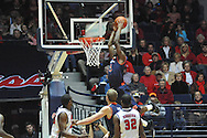 "Ole Miss vs. Auburn's Shaquille Johnson (5) dunks at the C.M. ""Tad"" Smith Coliseum on Saturday, February 23, 2013.  (AP Photo/Oxford Eagle, Bruce Newman)"