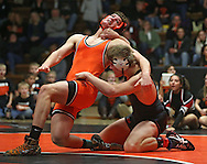 Prairie's Jesse Hynek (from left) is pulled down by Linn-Mar's Andrew Holladay during the 195-pound bout of the dual between Linn-Mar and Cedar Rapids Prairie at Prairie High School in Cedar Rapids on December 12, 2013.