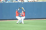 Mississippi's Auston Bousfield (9) makes a catch and avoids a collision with teammate Tanner Mathis (12) against Mississippi State at Oxford-University Stadium  in Oxford, Miss. on Saturday, May 11, 2013. Mississippi won the first game of a double header 3-0. (AP Photo/Oxford Eagle, Bruce Newman)